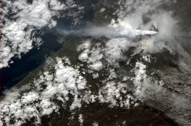 Image: Italy's Mount Etna streaming ash after it erupted is pictured in this handout photo taken by Canadian astronaut Chris Hadfield
