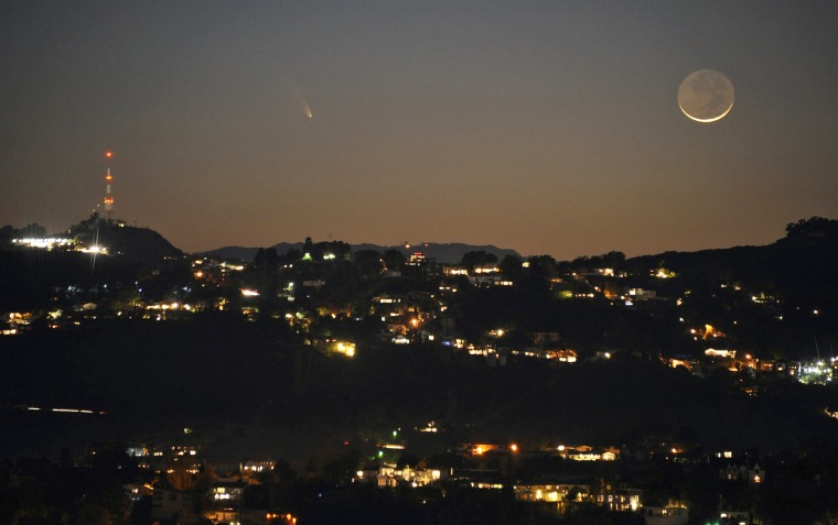 Image: The comet PANSTARRS is seen next to the waxing crescent moon off the western coast of Southern California, in Los Angeles