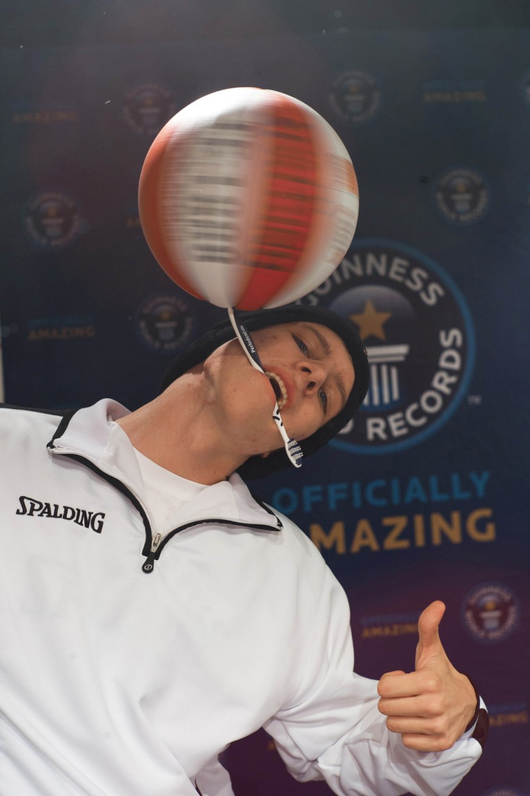 The longest duration spinning a basketball on a toothbrush is 26.078 seconds and was set by Michael Kopp (Germany) at Fliegende Bauten in Hamburg, Germany, on 14 November 2012 to celebrate Guinness World Records Day. This was the first (and successful) try ever to set a world record for 18-years-old basketball-freestyler Michael Kopp, when he doubled the time of the previous record. His reason for participating in GWR day was that he wanted to be in the same line-up as his sporting idol Joe Alexander, who set two new world records in the same event.