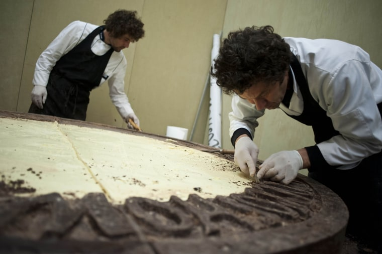 The largest chocolate coin weighs 658kg (1450 lbs), measures 196cm in diameter and is 17cm thick. It was created by the master chocolatiers at the Cioccoshow Exhibition, during an event arranged by BF Servizi (Italy), in Bologna, Italy on 15 November 2012 to celebrate Guinness World Records Day.
