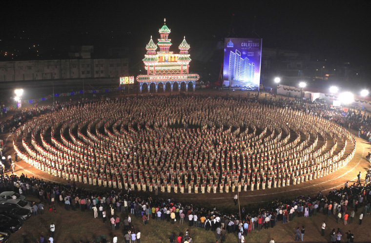 The record for the largest kaikottikali dance is 2,639 participants achieved by the Mumbai Pooram Foundation in Mumbai, India in November to celebrate Guinness World Records Day 2012.  Kaikottikali , or thiruvathirakali, is the most famous group-dances of the women of Kerala .This form of dance has generally eight to ten women dancing in a symmetrical form with rhythm. The dancers move in a circular pattern, accompanied by rhythmic clapping of the hands, to the tune of the song (Thiruvathira pattu).  They move in circular motion, clockwise and at times anticlockwise, with all performers bend sideways, with theirs arms coming together in graceful gestures, upwards and downwards and to either side, in order to clap. A dance of this scale is unprecedented.