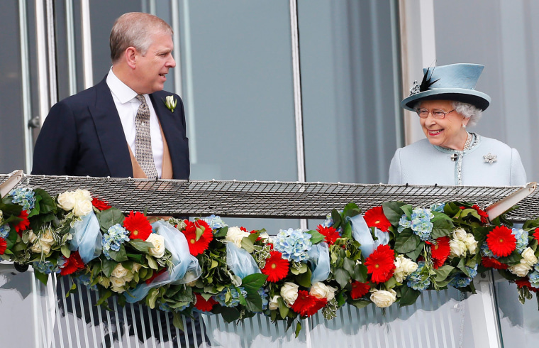 Image: Britain's Queen Elizabeth smiles at the Epsom Derby as she speaks with Prince Andrew in Epsom, south of London