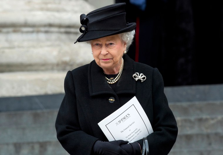 Image: Britain's Queen Elizabeth leaves after attending the funeral service for former British prime minister, Margaret Thatcher, at Saint Paul's Cathedral, in London