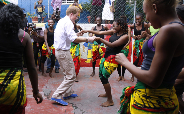 Image: Britain's Prince Harry dances with Dormer at a youth community center in Kingston, Jamaica