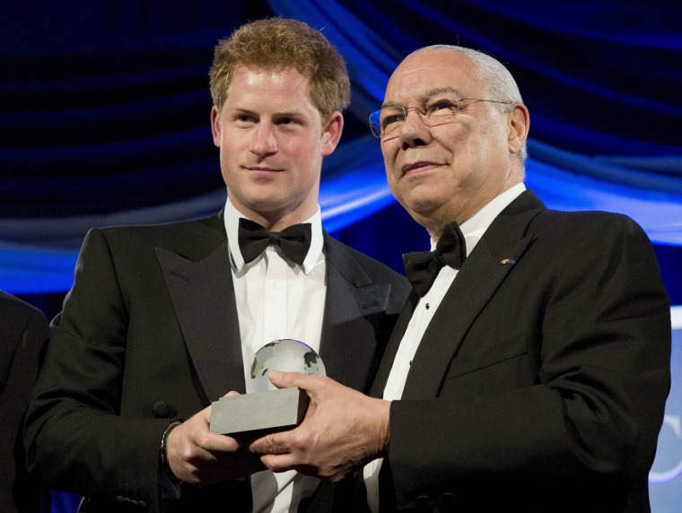 Image: Britain's Prince Harry stands with former U.S. Secretary of State Colin Powell as he receives the Humanitarian Award from the Atlantic Council during their annual awards dinner in Washington