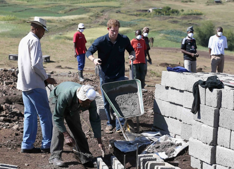 Image: Britain's Prince Harry helps lay the foundations for the new Sentebale Mateanong Herd Boy School, in Mokhotlong, Lesotho