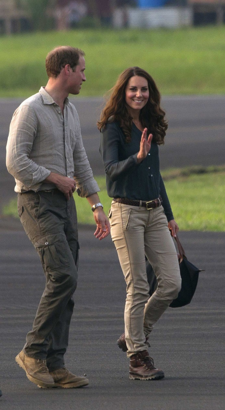 Image: Britain's Prince William and Catherine, Duchess of Cambridge wave farewell before leaving Lahad Datu airport, on the island of Borneo