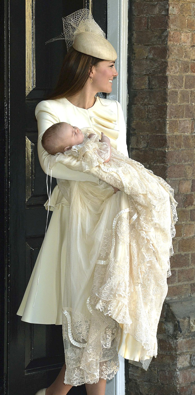 Image: Britain's Catherine, Duchess of Cambridge carries her son Prince George after his christening at St James's Palace in London