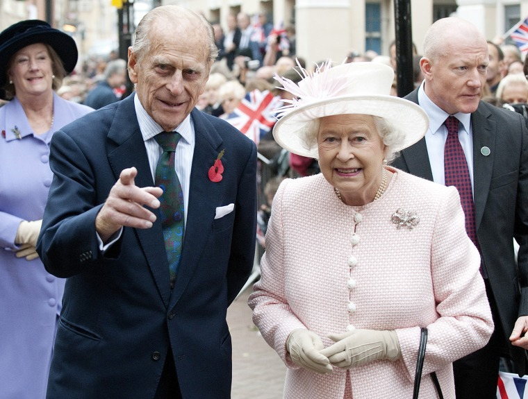 Image: Britain's Queen Elizabeth and Prince Phillip walks through the old town during a visit to Margate, in Kent, southern England