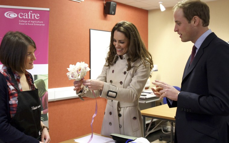 Image: Britain's Prince William and his fiancee, Kate Middleton, speak to wedding florist Rachel Gibson, during a visit to the Greenmount Agriculture & Food College, in Antrim