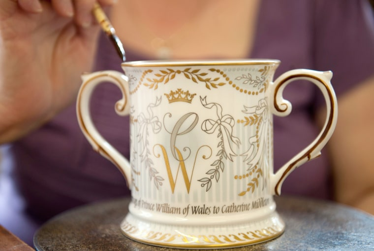 Image: Worker Linda Hancox gilds the first of a limited edition of 1000 Loving Cups, to be part of the official Royal Wedding commemorative china, at a factory  in Stoke-on-Trent, in central England