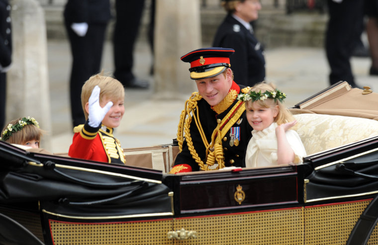 Britain's Prince Harry (2nd R), travels