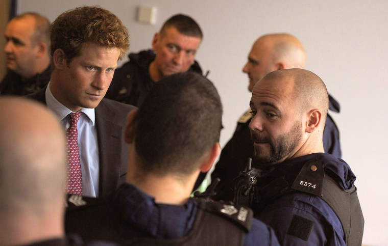 Image: Prince Harry Meets Emergency Services Crews On Duty During The Riots