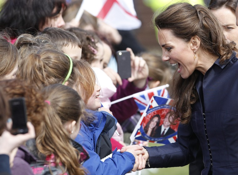 Image: Kate Middleton, the fiancee of Britain's Prince William talks to children during their visit to Witton Country Park in Darwen, northern England