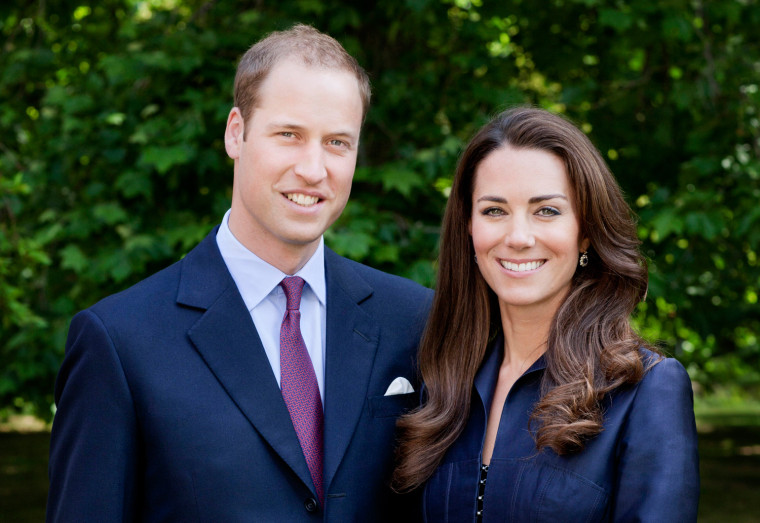 Image: Britain's Prince William and Catherine, Duchess of Cambridge pose for the official tour portrait for their trip to Canada and California, in the gardens of Clarence House in London