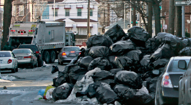 Image: Trash piled higher than cars in New York