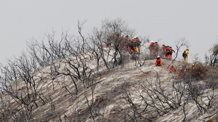 Image: Firefighters fight a wildfire in the Angeles National Forest