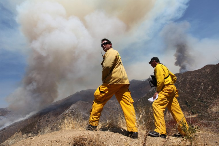 Image: Mitch Brookhyser, Denis Cross examine the Williams Fire