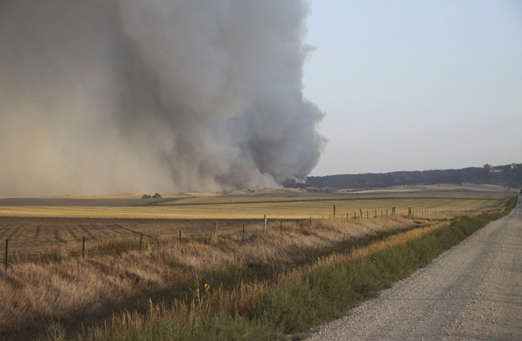 Image: Handout photo of smoke rising from the Nebraska plains at the Region 23 Complex fire near Crawford