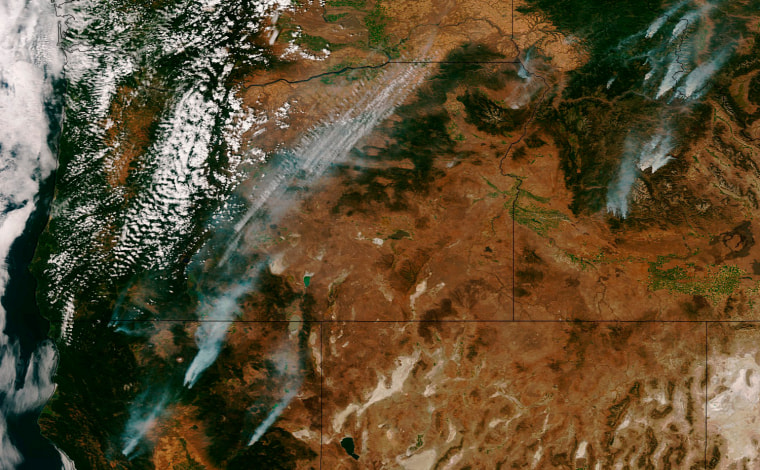 Image: Handout photo of the Suomi NPP satellite captured imagery of the Western U.S. wildfires that have been ravaging California, Oregon, and Idaho for weeks