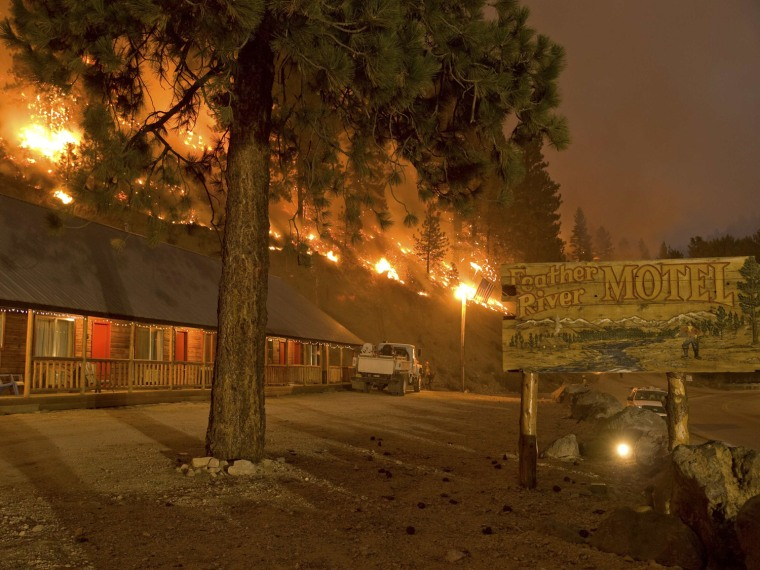 Image: Handout photo of a forest burning next to the Feather River Motel in Boise National Forest in the community of Featherville