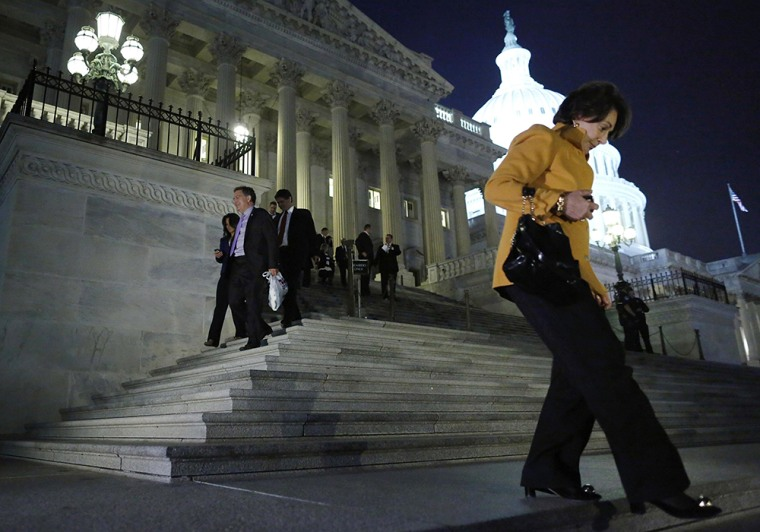 Image: Members of the House of Representatives depart after a late-night vote on fiscal legislation to end the government shutdown at the U.S. Capitol in Washington.