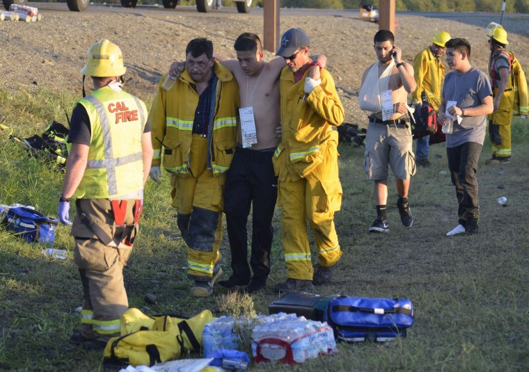 Image: Emergency personnel help a survivor of a wreck at the scene of a traffic collision on Interstate 5 near Highway 32 near Orland, California