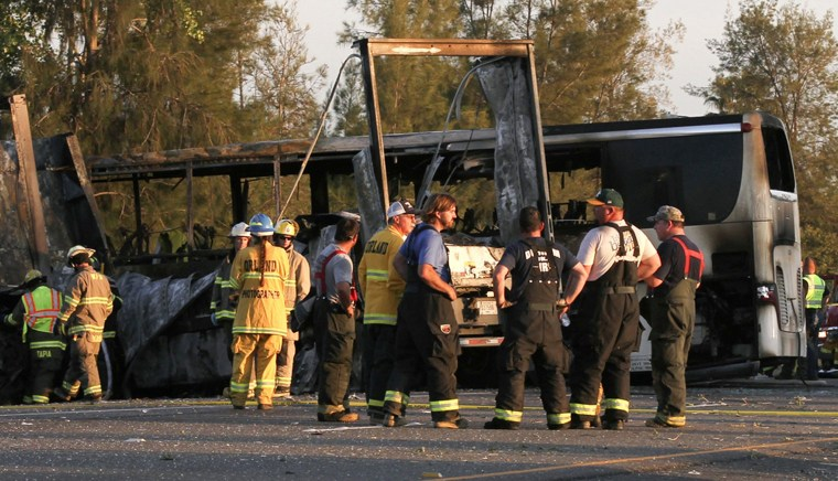 Image: Rescue workers, police and firefighters survey the scene where a truck and a tour bus collided near Orland