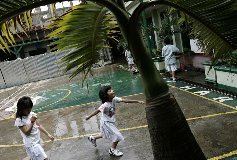 ** FILE ** In this  Jan. 23, 2007 file photo, Indonesian school girls run on the playground at the SDN Menteng 1 school in Jakarta, Indonesia. President-elect Barack Obama attended the school when he was a child. Places that U.S. presidents have called home often become major tourist attractions, from estates at Mount Vernon and Monticello, to Hodgenville, Ky., where Abe Lincoln's log cabin once stood. But if you want to see all the places connected to Obama's life story, you'd need to visit three countries, five time zones and six states. (AP Photo/Ed Wray, File)
