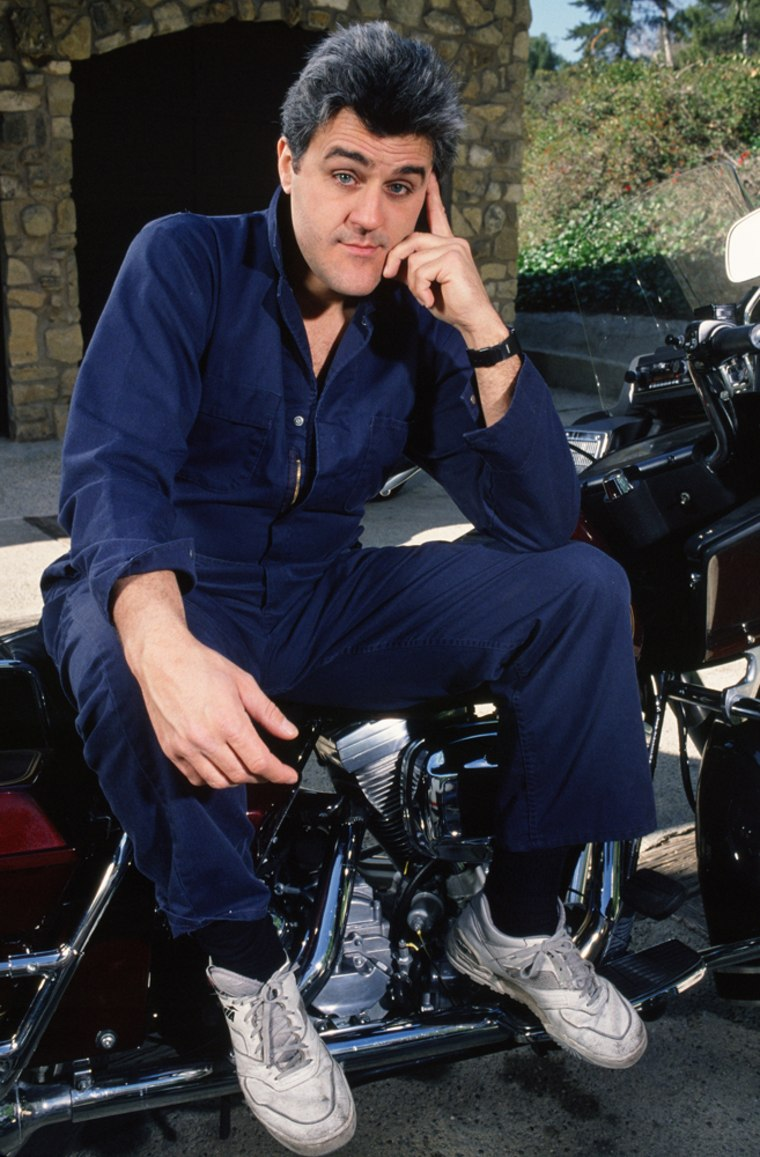 """Leno poses with one of his many motocycles. An avid collector, he auctioned off a Harley-Davidson autographed by celebrity """"Tonight Show"""" guests in 2001 to help victims of the Sept. 11 attacks."""