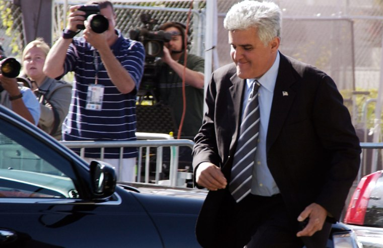 """Leno leaves the Santa Barbara County Courthouse in Santa Maria, Calif., on May 24, 2005, after serving as a defense witness in Michael Jackson's child molestation trial. As part of a gag order issued during the trial, Leno was barred from making jokes about the singer in his """"Tonight"""" monologues. After NBC challenged the order, the judge amended it, allowing the host to joke about Jackson as long as the jokes didn't relate to his testimony."""
