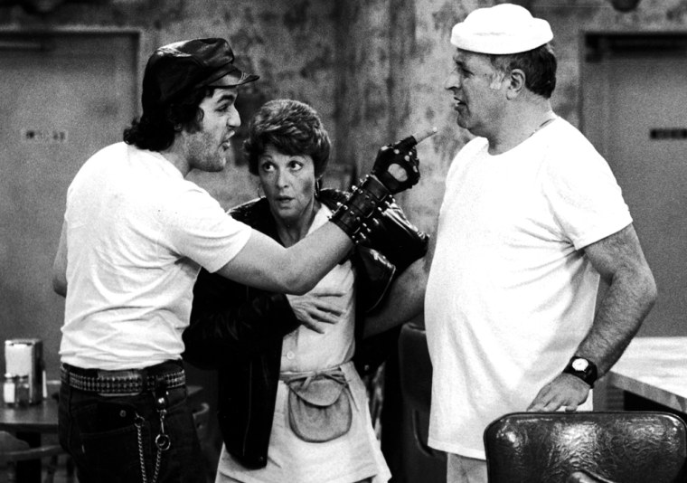 """Leno made a guest appearance as a biker on the TV series """"Alice,"""" playing alongside Vic Tayback, right, and Linda Lavin. Leno has a passion for motorcycles in real life, and a large collection to show for it."""