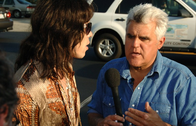"""Leno films an installment of his popular Jay Walking segment for """"The Tonight Show."""" In the segment, he picks random strangers on the street and asks them questions about history and current events to often very funny results."""