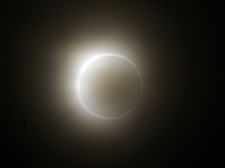 The moon passes between the sun and the earth during an annular solar eclipse as seen from Anyer Beach