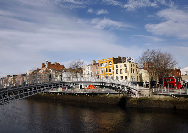 The Ha'Penny Bridge on the river Liffey in Dublin, Ireland.