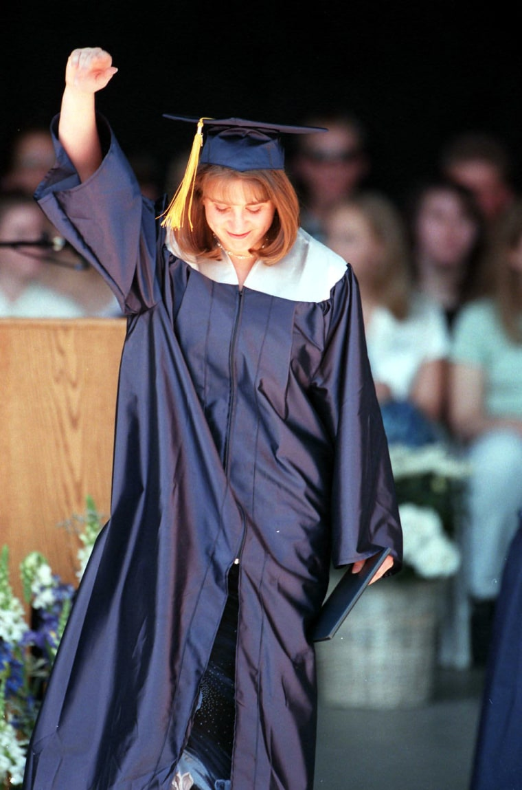 Columbine High School graduate and shooting victim Valeen Schnurr acknowledges the cheers as she leaves the Fiddler's Green stage, diploma in hand during graduation ceremonies. SH00D320COLUMBINESCHNURR Denver, April 19, 2000 _ Columbine High School graduate and shooting victim Valeen Schnurr acknowledges the cheers as she leaves the Fiddler's Green stage, diploma in hand, during graduation ceremonies. (SHNS photo by Mark Piscotty / The Rocky Mountain News) (Newscom TagID: shnsphotos093554)     [Photo via Newscom]