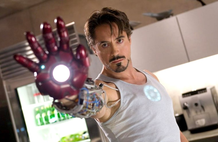 """IRON MAN - - Based on the long-running Marvel comic book series, """"Iron Man"""" tells the story of Tony Stark, the enigmatic heir to the Stark Enterprises fortune. A driven inventor and executive who seems to have it all, Tony is haunted by his dark side. Though he commands his empire by day, by night he secretly becomes """"Iron Man,"""" the living embodiment of decades of defense spending and innovation. Strapping on billions of dollars worth of state-of-the-art armor and weaponry each night to fight crime, terrorism and corporate espionage, Tony begins to crack under the strain of his fractured lifestyle and must ultimately confront the one enemy he can never beat -- himself."""