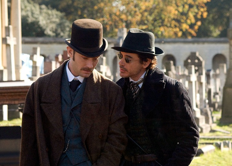 """(L-r) JUDE LAW as Dr. Watson and ROBERT DOWNEY JR. as Sherlock Holmes  Guy Ritchie has come aboard to direct, based on Lionel Wigram's upcoming comic book """"Sherlock Holmes.""""  The logline remains under wraps, but executives at Warners are aiming to reinvent Holmes and sidekick Dr. John H. Watson. Wigram's noted that the new Holmes would be more adventuresome and take advantage of his skills as a boxer and swordsman."""