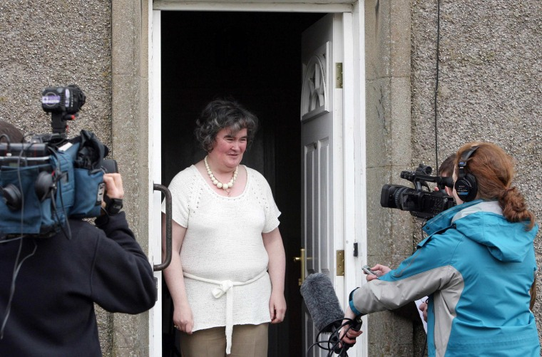 "Susan Boyle, who's performance on the television show ""Britain's Got Talent"" wowed the judges, faces the media at her home in Blackburn, Scotland, Thursday April 16, 2009. The frumpy 47-year-old, who says she's never been kissed, has gained celebrity fans and millions of admirers - including a fair number of men - since appearing on the show. Her fame has been fueled by new technology, with a clip of her performance viewed more than 12 million times on YouTube.(AP Photo/Andrew Milligan-pa)  **UNITED KINGDOM OUT: NO SALES: NO ARCHIVE: **"