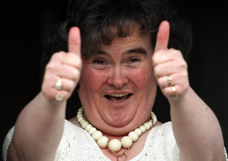 "Susan Boyle, who's performance on the television show ""Britain's Got Talent"" wowed the judges, gives the thumbs up at her home in Blackburn, Scotland, Thursday April 16, 2009. The frumpy 47-year-old, who says she's never been kissed, has gained celebrity fans and millions of admirers - including a fair number of men - since appearing on the show. Her fame has been fueled by new technology, with a clip of her performance viewed more than 12 million times on YouTube.(AP Photo/Andrew Milligan-pa)  **UNITED KINGDOM OUT: NO SALES: NO ARCHIVE: **"