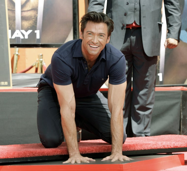 "Hugh Jackman, star of ""X-Men Origins"" places his hands in cement during a ceremony outside Grauman's Mann Chinese Theater Tuesday, April 21, 2009 in Los Angeles.  (AP Photo/Nick Ut)"