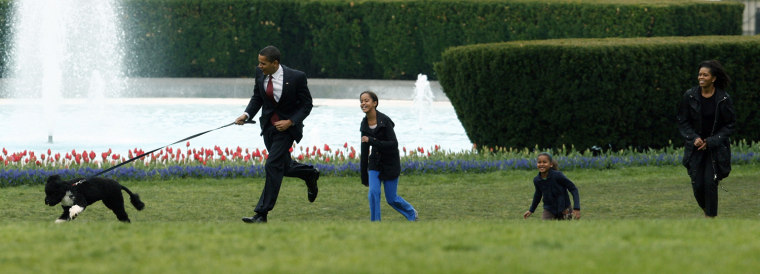 U.S. President Obama runs with family and new pet dog Bo on the South lawn at the White House in Washington