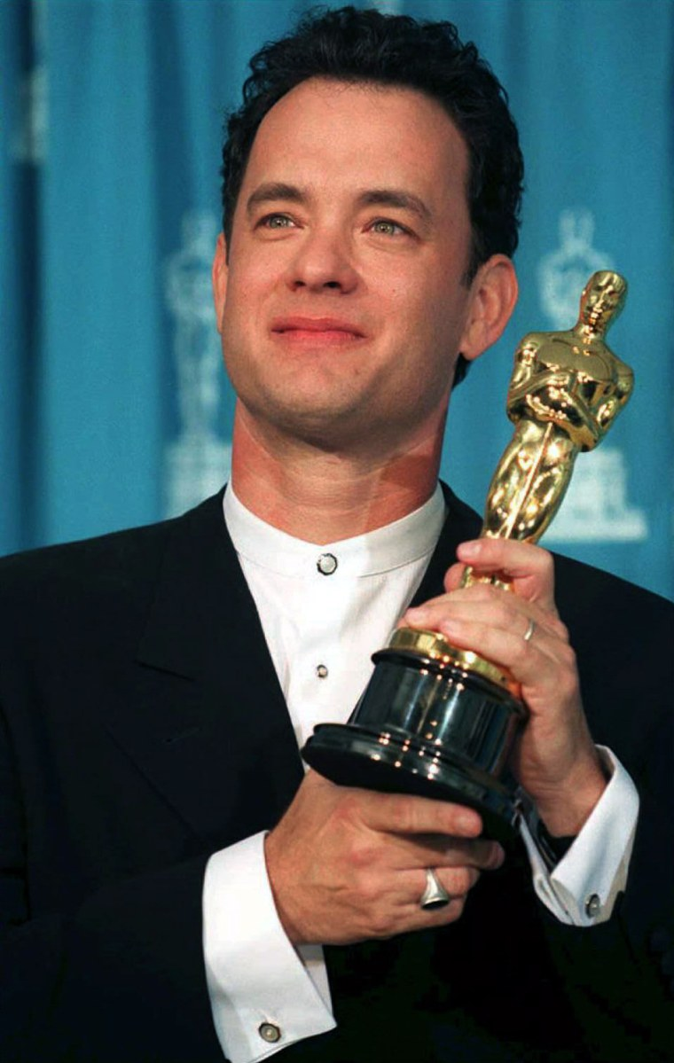 US actor Tom Hanks poses with his Oscar 27 March a