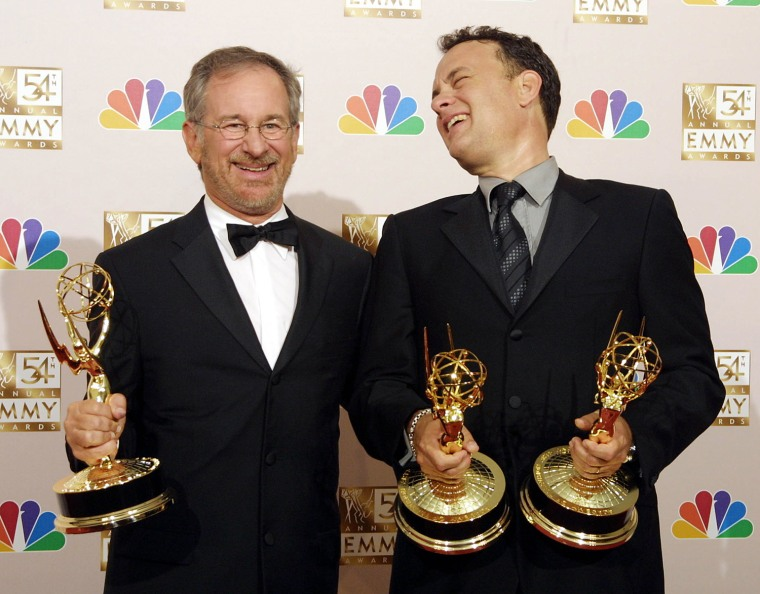 Steven Spielberg (L) and Tom Hanks (R) hold their