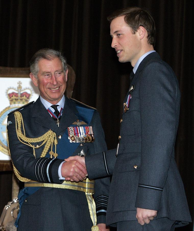 Britain's Prince William (R) receives hi