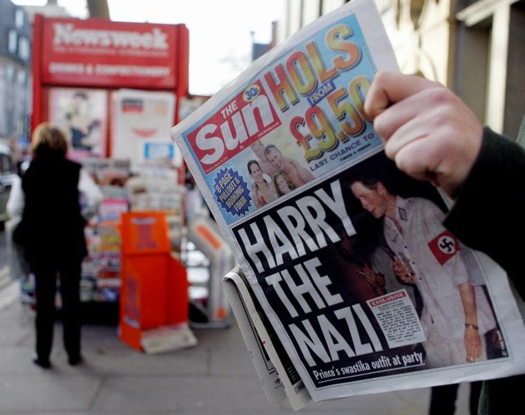 "A man reads the newspaper ""The Sun"" in L"