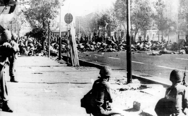 BLACK FRIDAY - This picture was frontpaged by Iranian newspaper Kayhan, Thursday, February 22, 1979, and capition stated it was taken in Jaleh square, Teheran, September 08, 1978. It shows Shah's troops who surrounded the crowd. Many victims lie in the middle of the street. Paper added that several of these pictures have been locked in a safe, waiting for the proper time to be published. (AP-PHOTO/em/HO)