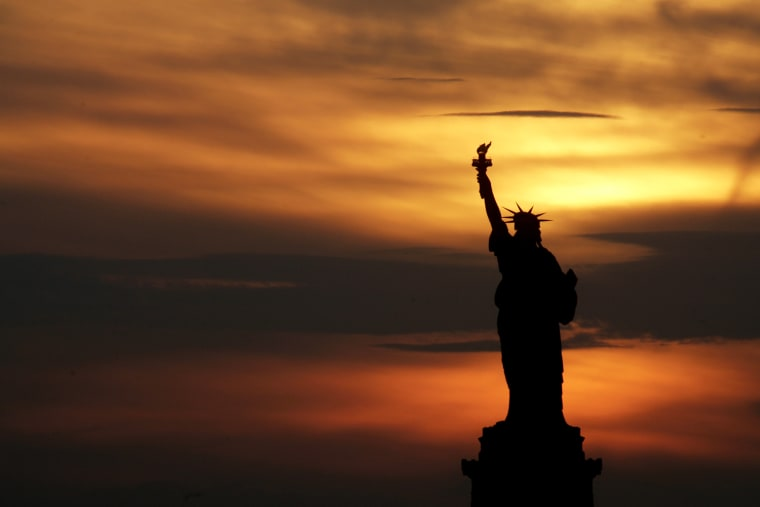 The Statue of Liberty is seen at sunset in New York, Tuesday, July 3, 2007.  The United States will be celebrating its 231st Independence Day tomorrow.  (AP Photo/Seth Wenig)