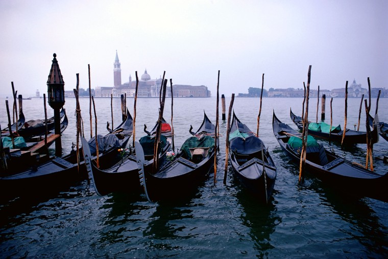 ** FOR IMMEDIATE RELEASE **Gondolas line the bank near Venice's grand canal with the San Giorgio Maggiore church in the background in this undated photo.  (AP Photo/Peter Deilmann Cruises)