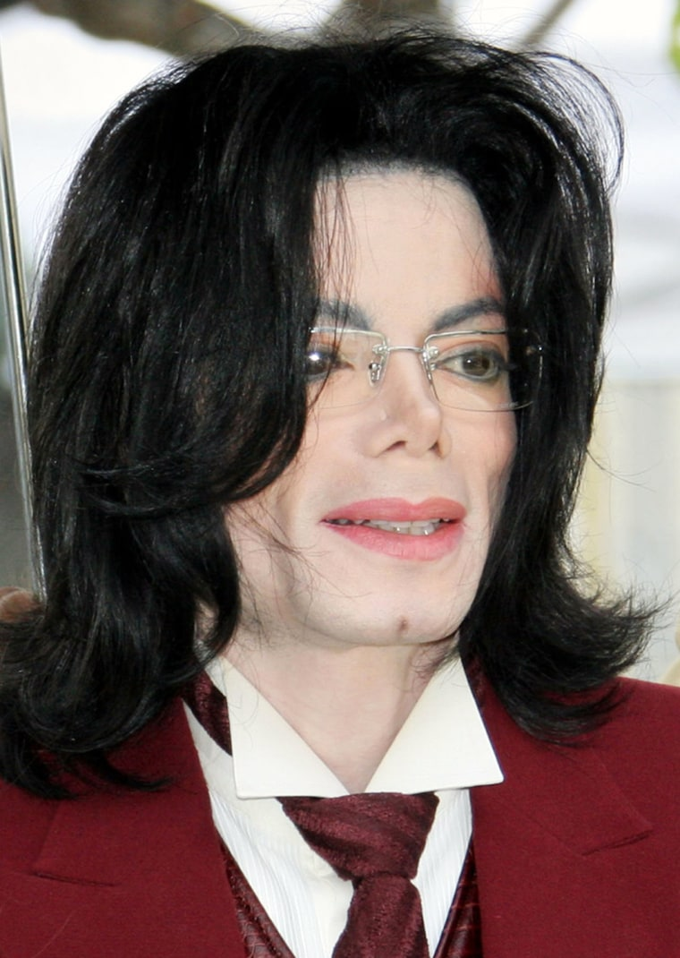 "** FILE ** Michael Jackson arrives at the Santa Barbara County courthouse in this April 27, 2005, file photo in Santa Maria, Calif.  Jackson plans to make his first public appearance since his trial acquittal last June at a ceremony in Tokyo to accept MTV Japan's ""Legend Award,"" his spokesman said. Jackson's participation in the award ceremony Saturday at Yoyugi Olympic Stadium will launch an Asian tour. Jackson also plans to visit Singapore, Shanghai and Hong Kong, spokeswoman Raymone K. Bain said in a telephone interview from her Washington, D.C., office Thursday, May 25, 2006. (AP Photo/Michael Mariant, file)"